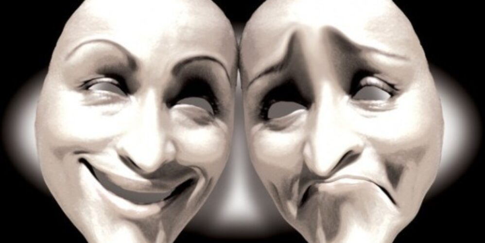 Graphic showing two masks one with happy and the other with a sad face to depict the extremes of human emotion and suffering